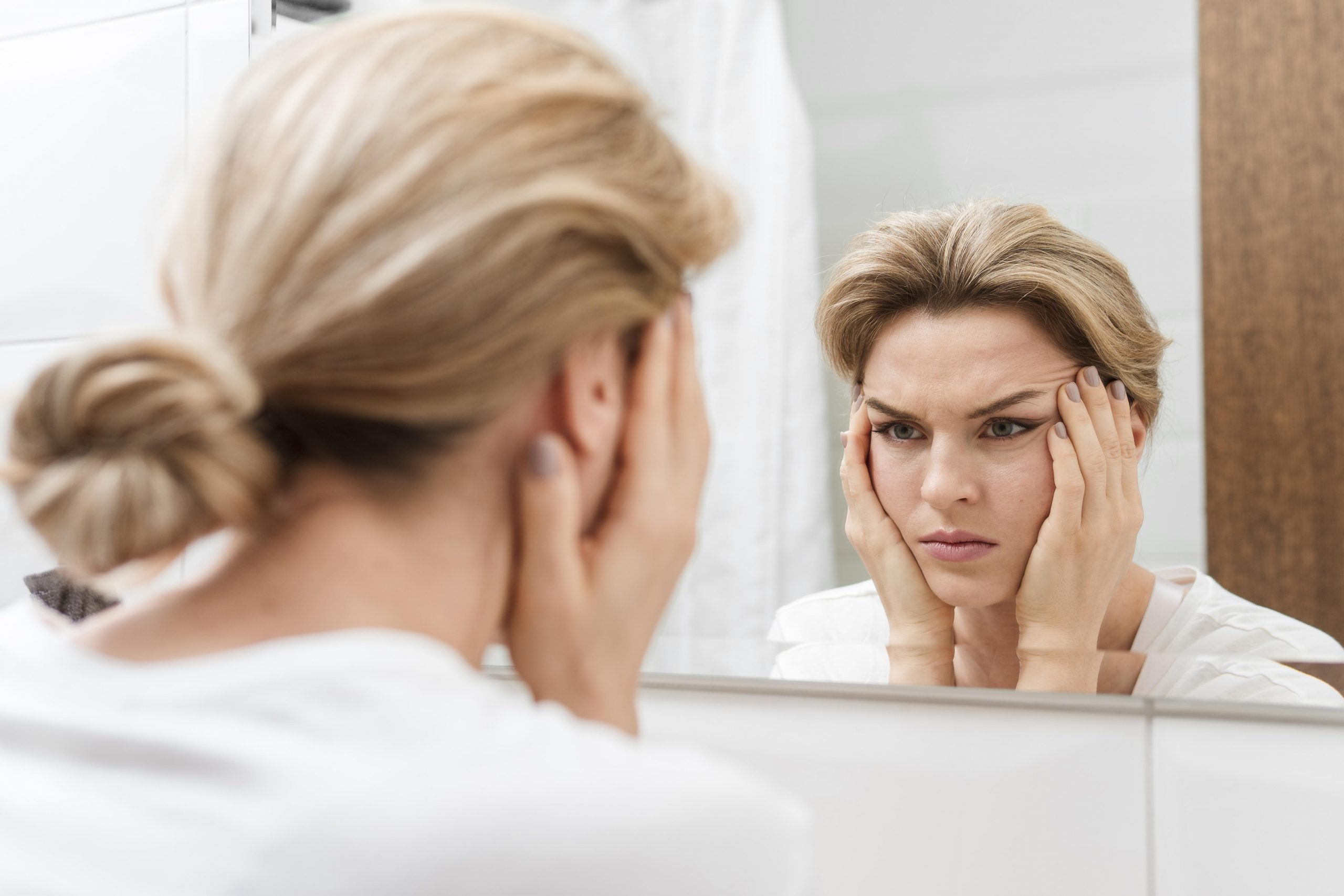 What are the visible effects  of facial aging?